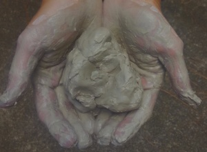 hands and clay