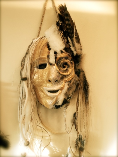 SHE comes to life, her dark and her shadow, the spiral of her ye as it weaves with the medicine of snake into her very being, the wolf the owl and the white hare, acknowledged as her kin, her resource, her love of the wild. Solstice mask, the medicine woman of polarities.